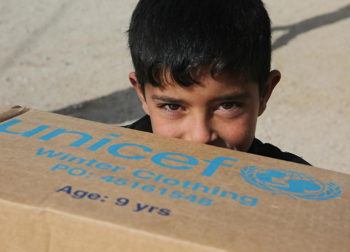 A young refugee from Syria receives warm winter clothing from UNICEF.