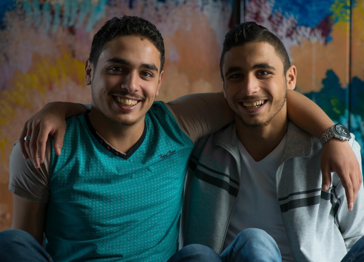 Syrian refugees Watheg, 21 (left), and his brother Harm, 18, participate in a weekly youth drama group at a UNICEF-backed Makani learning center in Mafraq, Jordan.