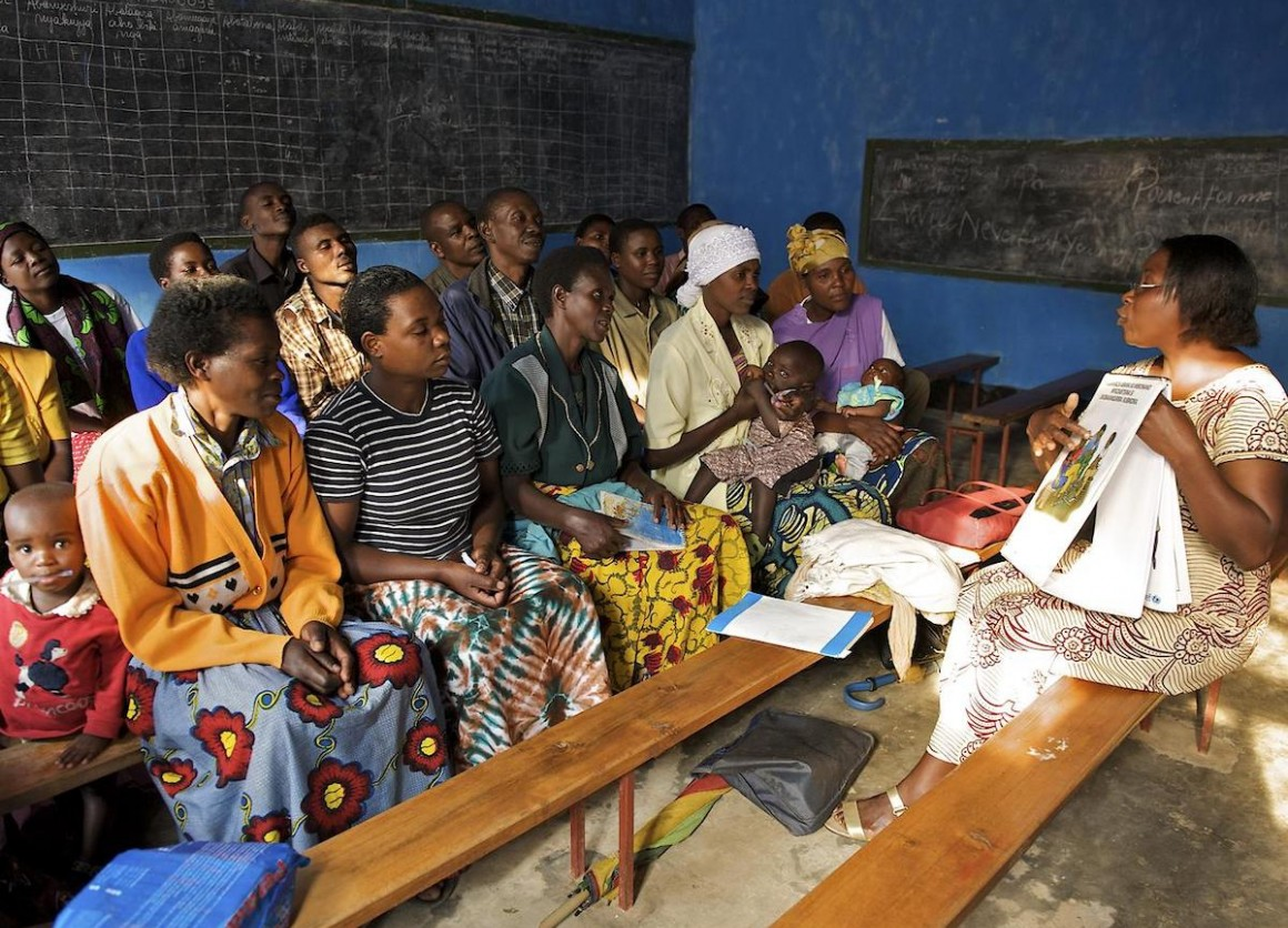 A UNICEF-supported female facilitator leads a Circle of Dialogue to discuss important social issues like health, hygiene, sanitation and HIV prevention at a church in the village of Rwaza in Musanze district, northern Rwanda.