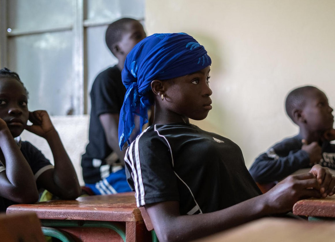 A UNICEF-supported program linking soccer and academics in Niamey, Niger keeps teenagers like Pascaline in school.
