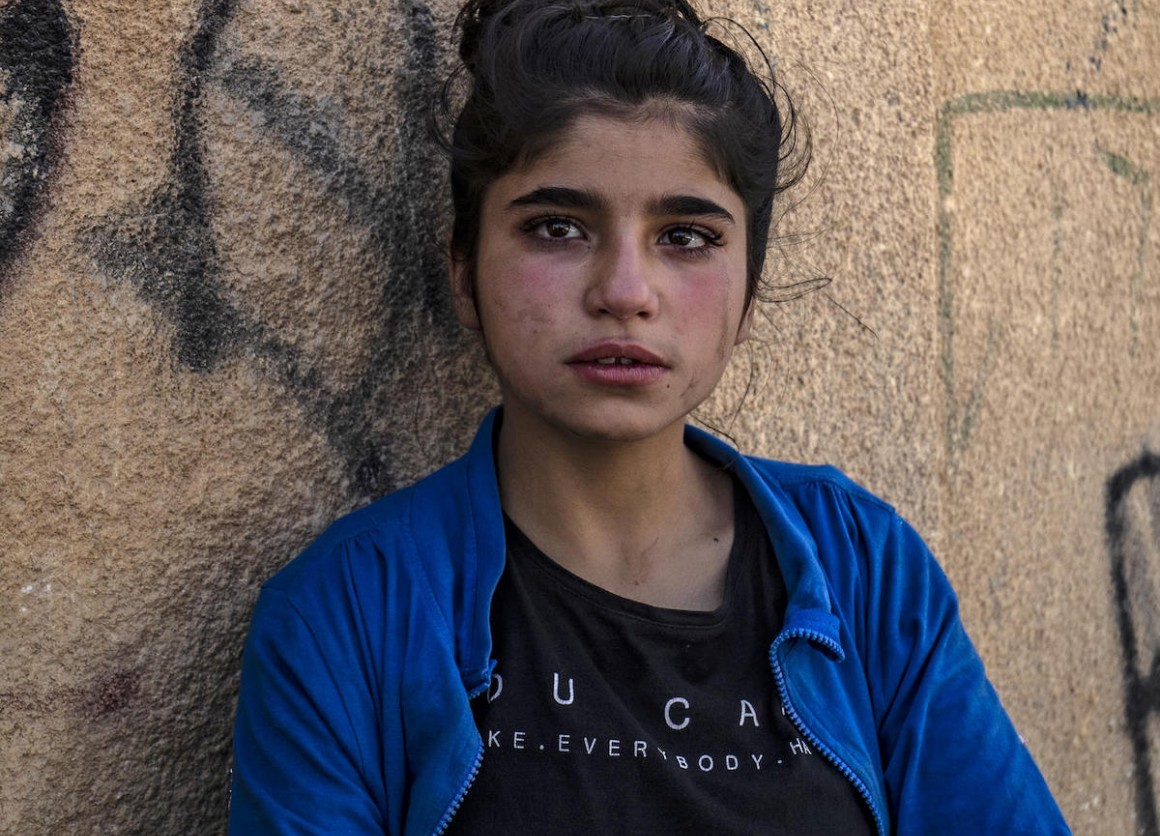 A Syrian girl cries upon her arrival in Hassakeh city after fleeing Turkish bombardment on Syria's northeastern towns along the Turkish border on October 10, 2019.