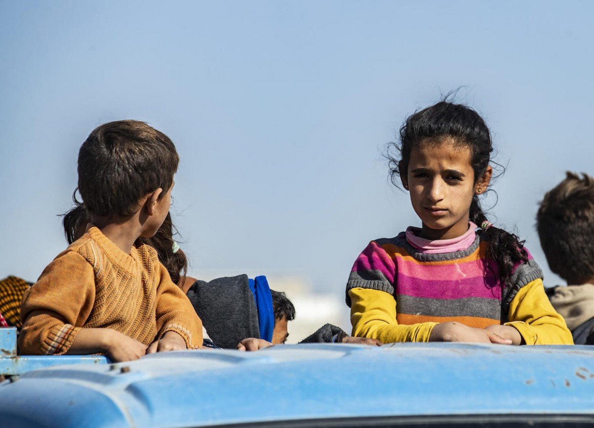 In October 2019, families fleeing escalating violence in northeast Syria continue to arrive in Tal Tamer, carrying only the bare essentials.