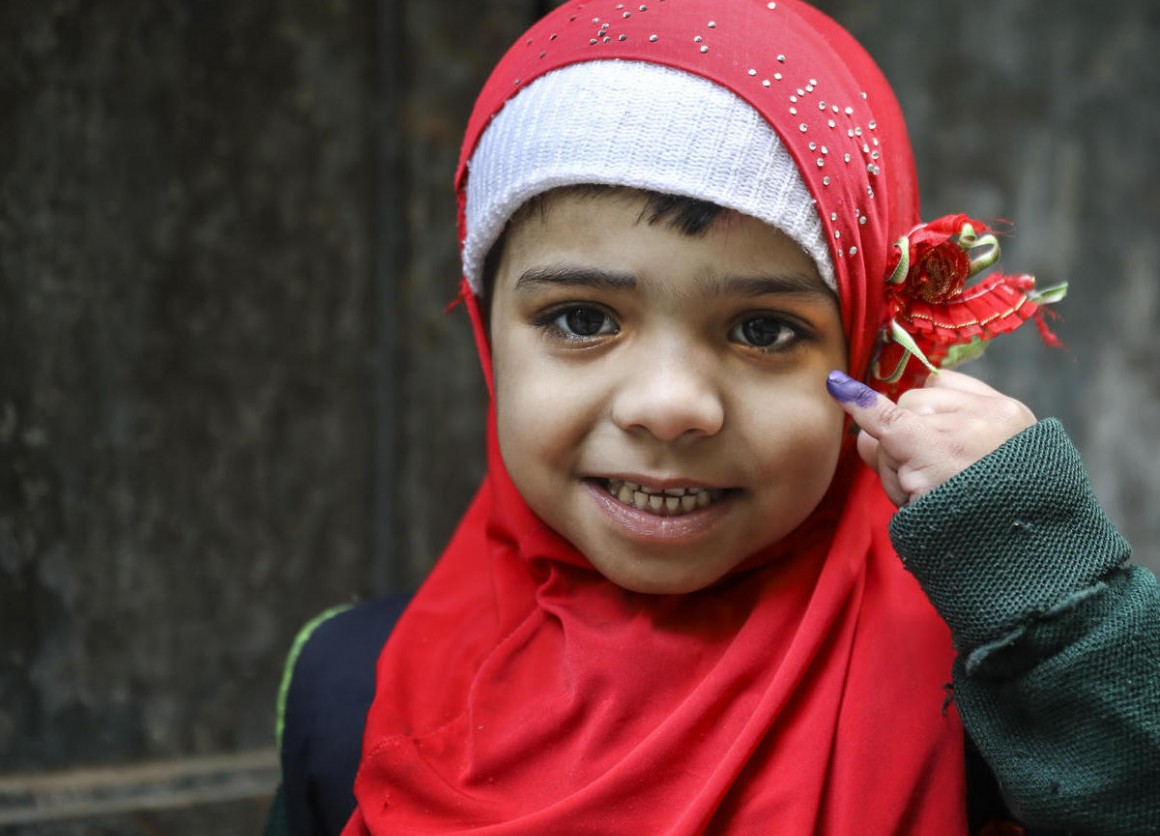 In January 2019, Aneesa, 5, shows the ink mark on her little finger that confirms she has received her polio vaccine from a UNICEF-supported vaccinator in the Bhatti gate area of Lahore Punjab Province, Pakistan.