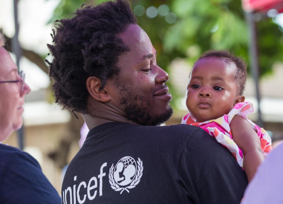 Ishmael Beah, author, former child soldier and UNICEF Advocate for Children Affected by War, holds a baby girl during a visit to Ola During Children's Hospital in Freetown, Sierra Leone, on 17 November 2019.