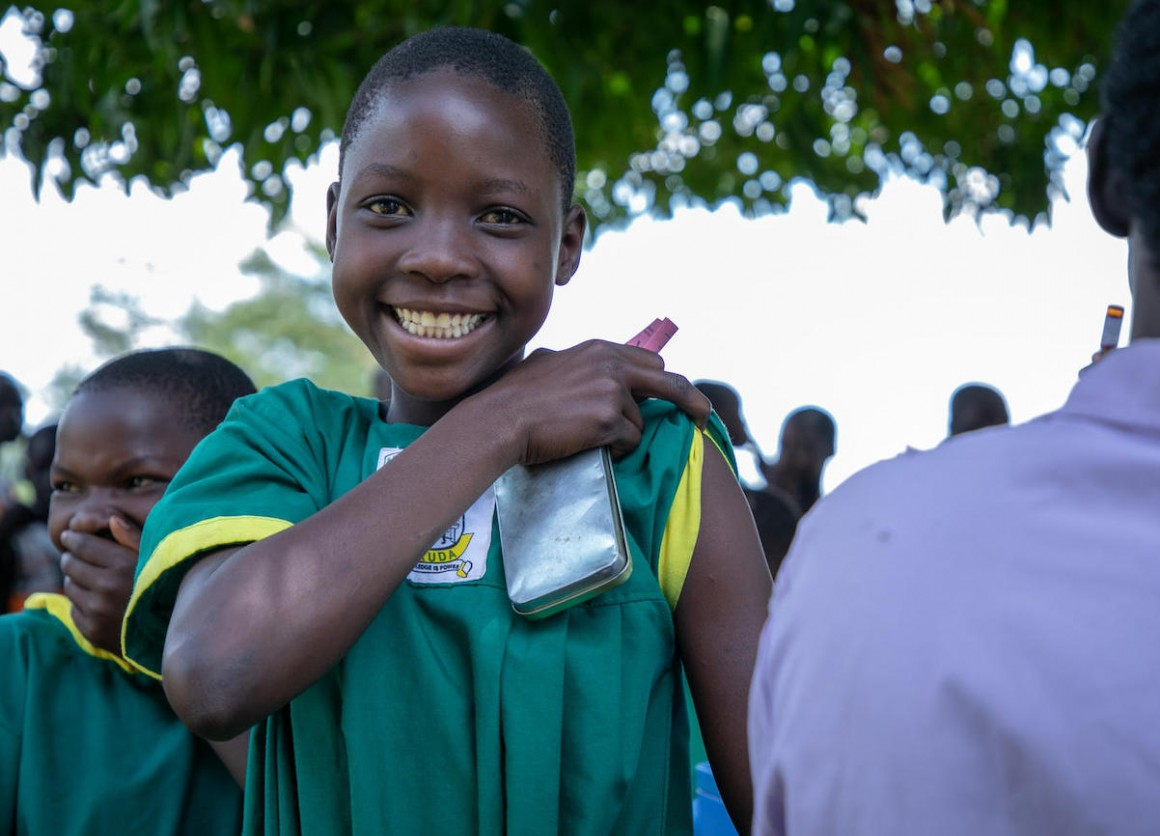 A happy girl prepares for her immunization against measles, mumps, rubella and polio during a nationwide campaign run by the Ugandan Government with support from UNICEF and WHO.