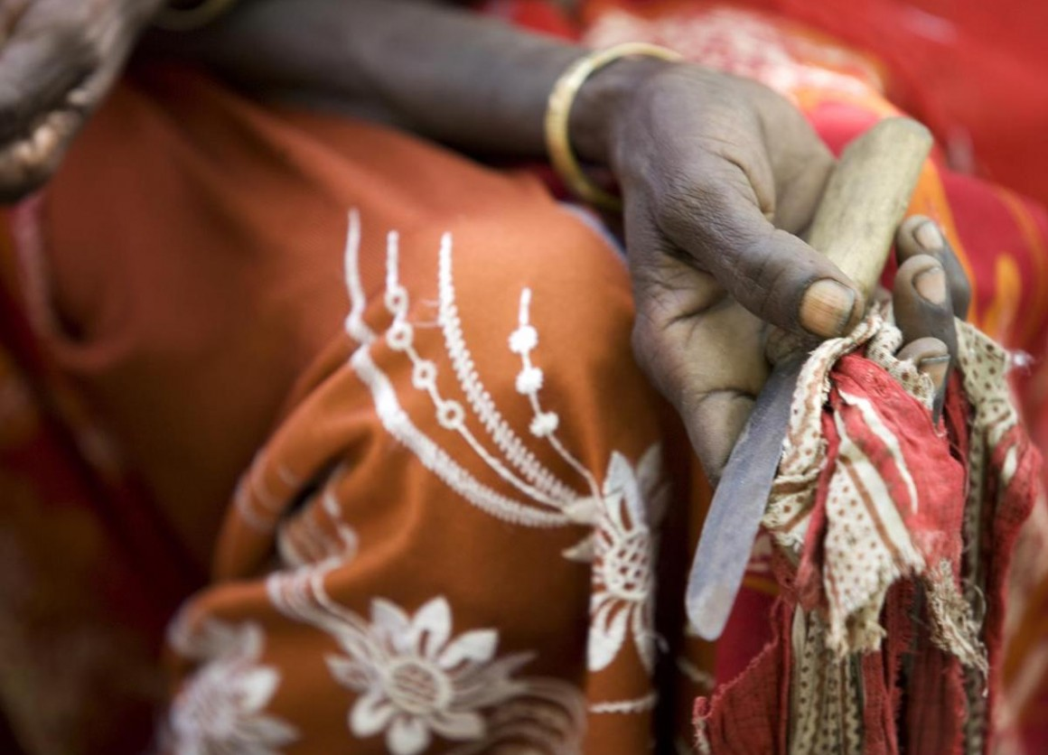 In Ethiopia's Afar Region, a former practitioner of female genital mutilation holds the tool she used to perform the procedure.