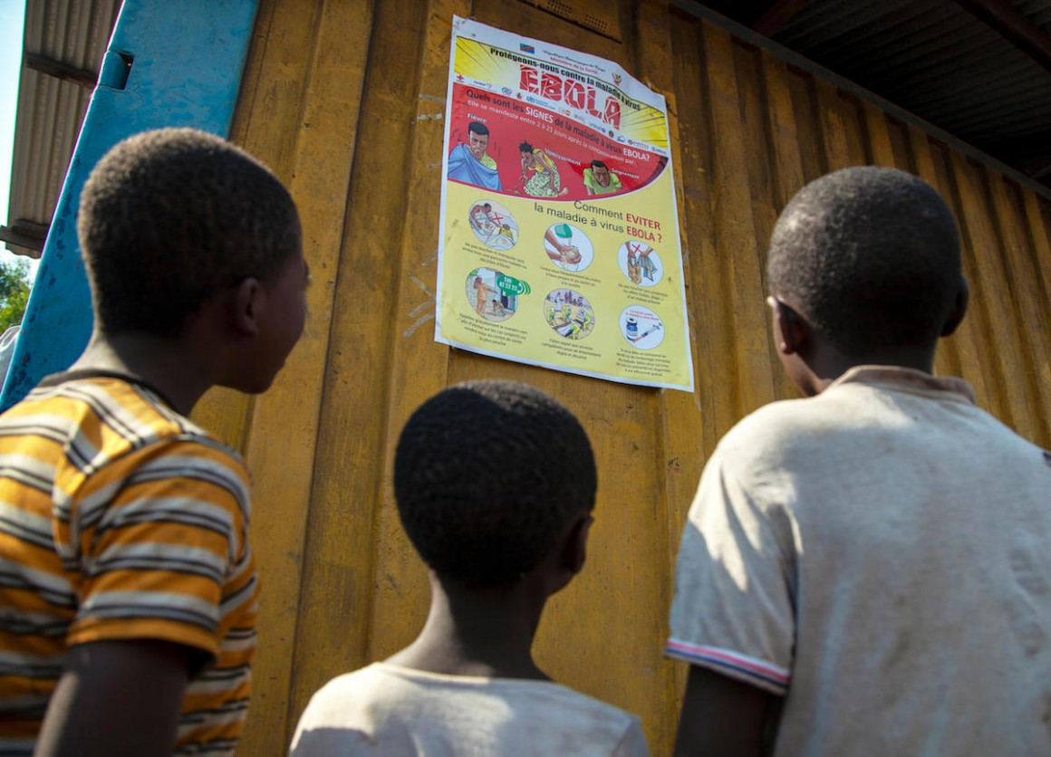 Children read an Ebola-awareness poster in North Kivu, the Democratic Republic of the Congo (DRC).