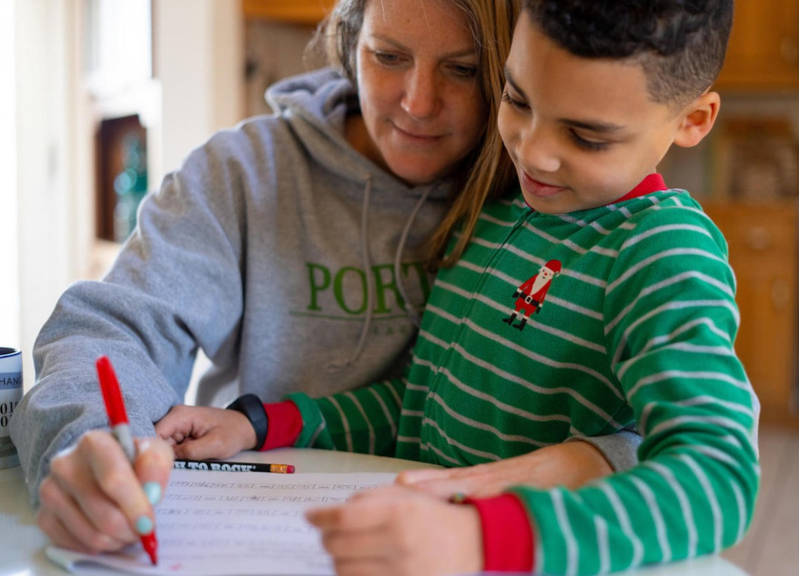 On the morning of 16 March 2020, 8-year-old second grader Luka works on a mathematics assignment at home in Connecticut, United States of America, with help from his mother, Sophia.