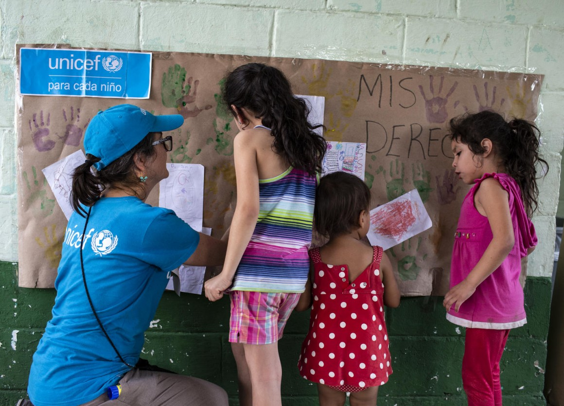 A UNICEF-supported Tech Palewi volunteer plays with children at the St. Augustine hotel for refugees and asylum seekers in Tapachula, Mexico, on January 30, 2019.