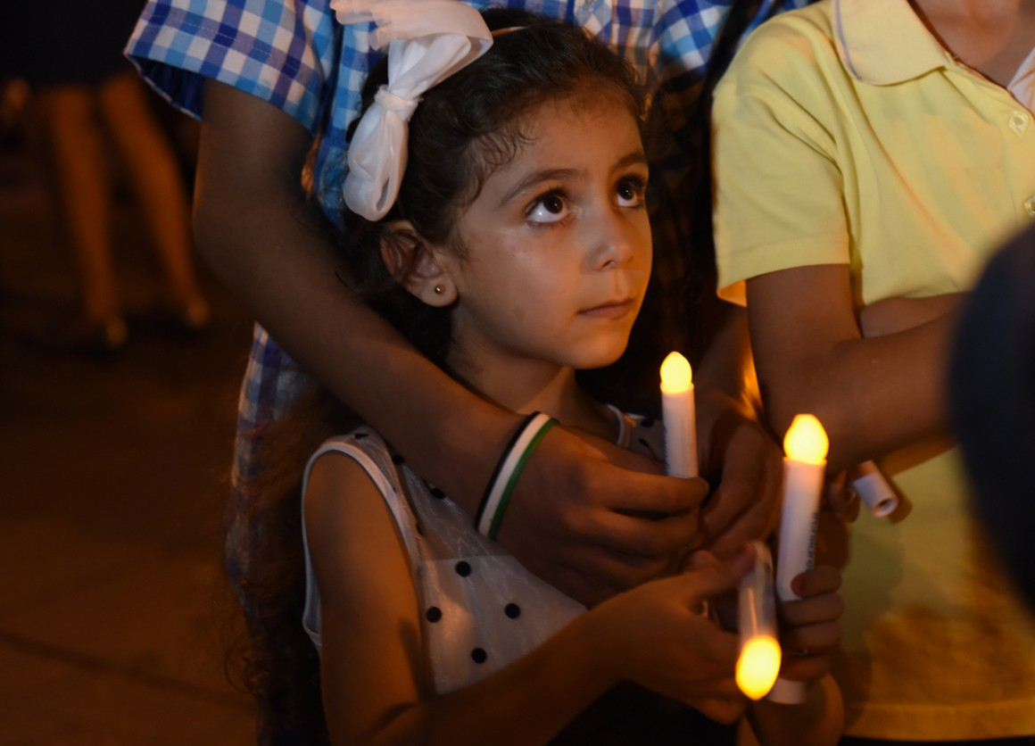 A young girl from Syria attends a candlelight vigil for child refugees at Dag Hammarskjold Plaza in New York City in September 2016.
