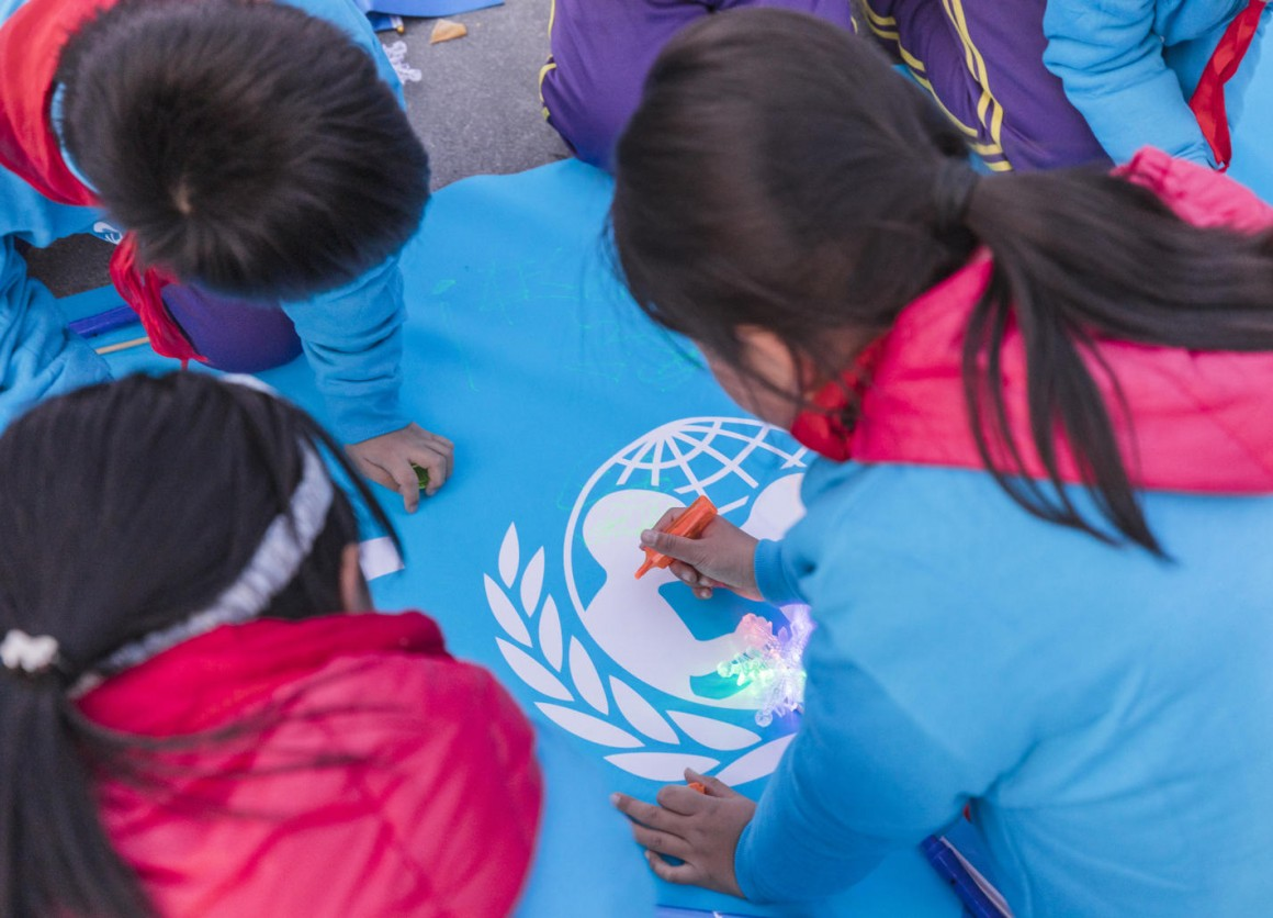 Children from Beijing write down their wishes to share with peers around the world at the Olympic Park in Beijing, China, on 20 November 2019.