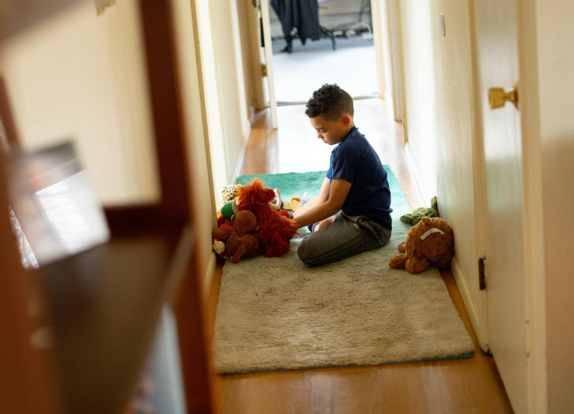 Luka, 8, plays with stuffed animals in between completing school work on his first day learning from home after his school in Connecticut closed due to the coronavirus outbreak.