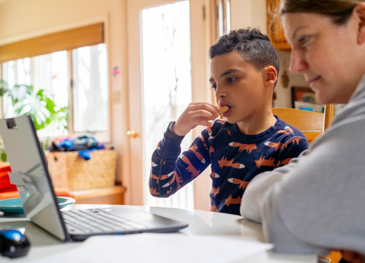 On the afternoon of 20 March 2020 in Connecticut, United States of America, Luka, 8, has a snack while working on a school assignment as part of his second grade class's distance learning measures. Local schools were closed indefinitely effective 13 March