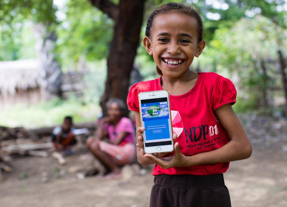 On April 14, 2020, a girl shows the online platform on which children and parents in Timor-Leste can find resources to help children continue their educations at home during the COVID-19 crisis.