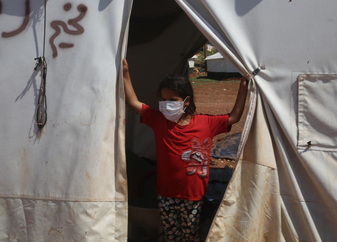On 19 April 2020, volunteers share messaging around staying safe and healthy during the time of the COVID-19 outbreak, in a tent camp for displaced Syrians near the town of Kafr Yahmoul, north of Idlib, Syrian Arab Republic.