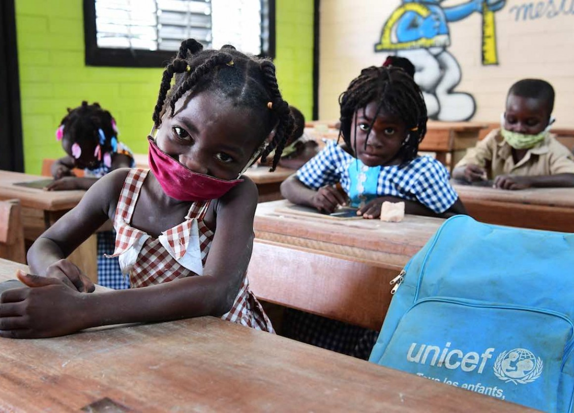 Children attending classes in Toumodi-Sakassou, in the center of Côte d'Ivoire.   Due to COVID-19, the schools were closed for several weeks. Classes started, with the necessary measures. Children wear masks, wash their hands regularly and keep a social d