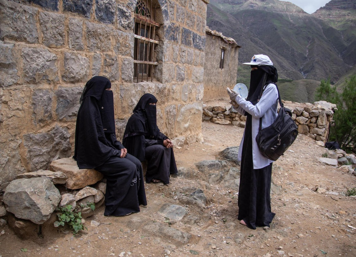 23-year-old Saba Muhammad Essa, a UNICEF-supported community health worker, travels on foot to reach families cut off from health services by fighting in Bait Essa, Emran governate, Yemen in 2020.