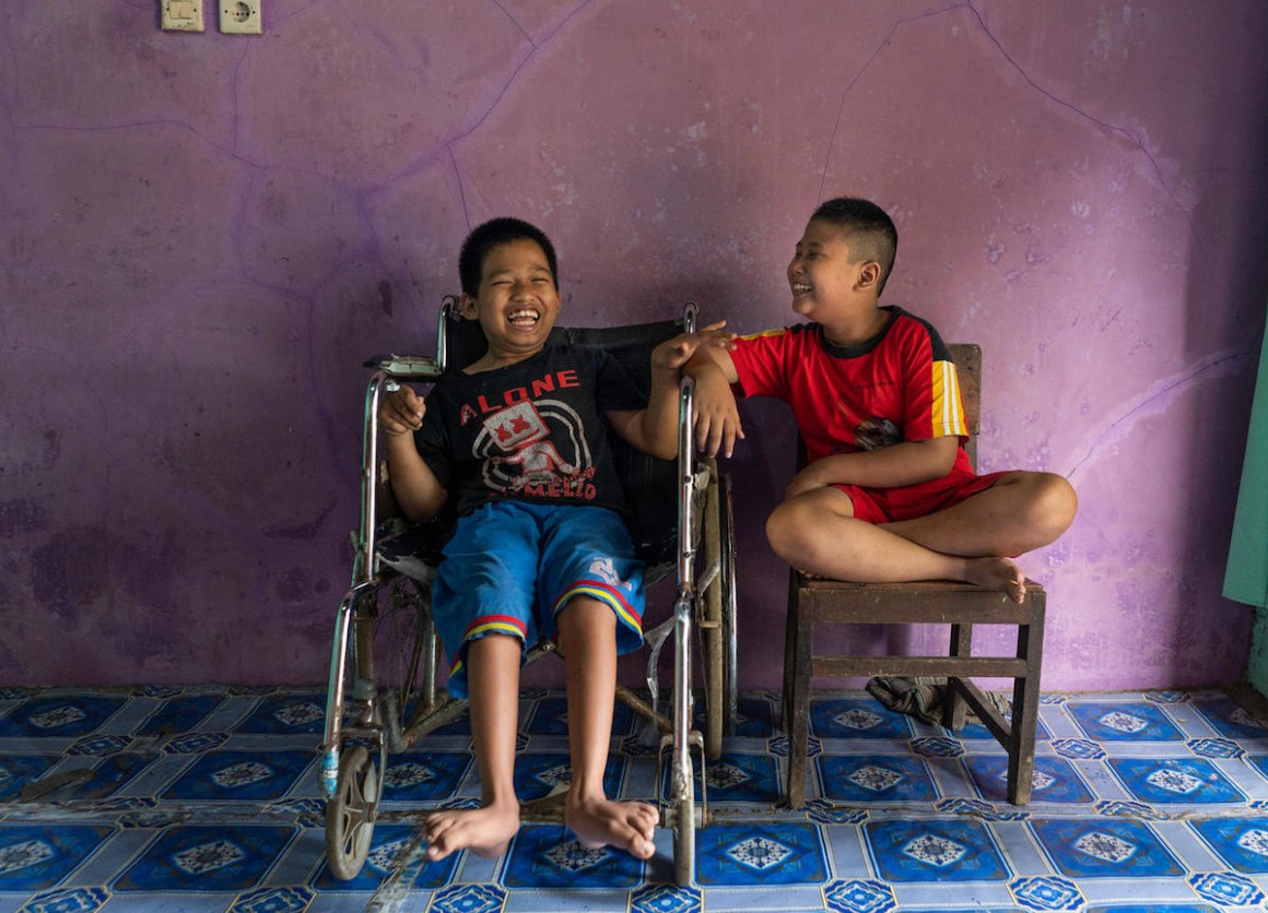 Syaiful (left), 12, a child with a physical impairment, sits next to his best friend, Kevin, 9, a child with a visual impairment, in Banyumas, Central Java, Indonesia. The boys attend a UNICEF-supported inclusive education program.
