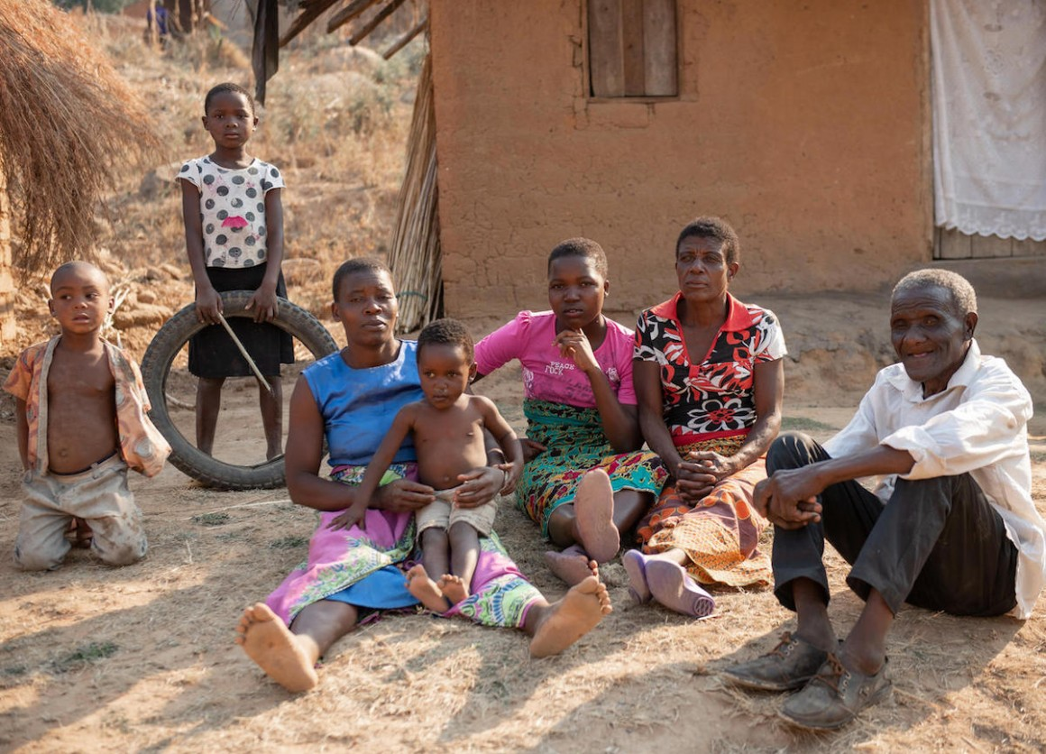 In Malawi's Ntcheu District, Wilson Kamwana, 84, far right, and his extended family use the $7 a month they receive from a UNICEF-supported unconditional cash transfer program to pay for basic necessities like soap, salt, sugar and school supplies.