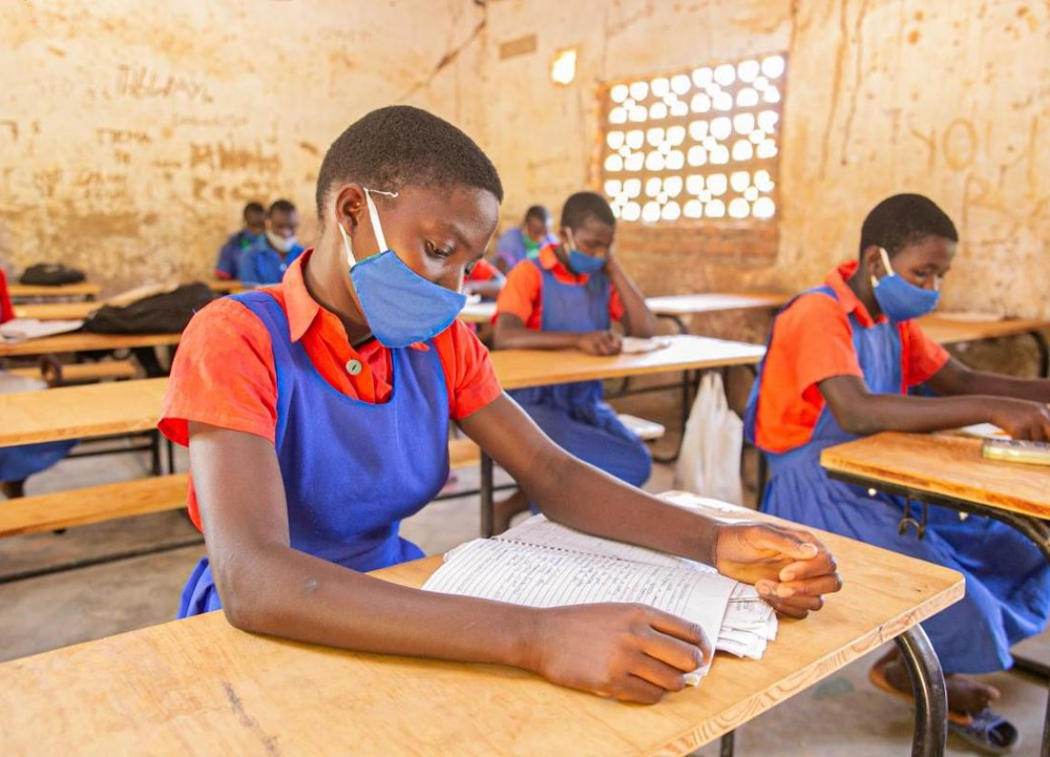 Having a desk helps students in Malawi maintain social distancing and prevent spread of COVID-19.