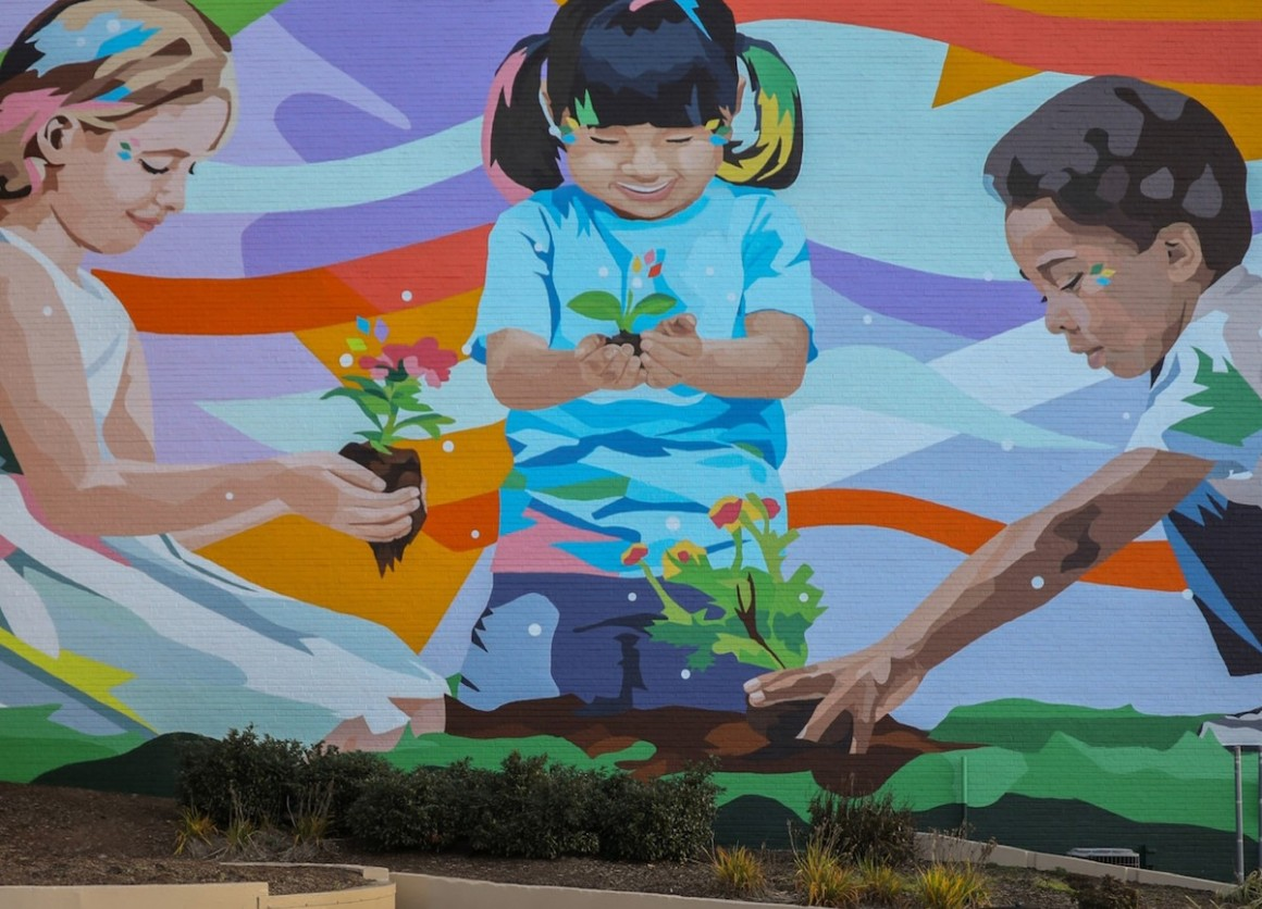 Painted by the artist Daas in 2020, a mural in downtown Johnson City, Tenn., features three children planting the seeds for a future rich in diversity and racial equality.