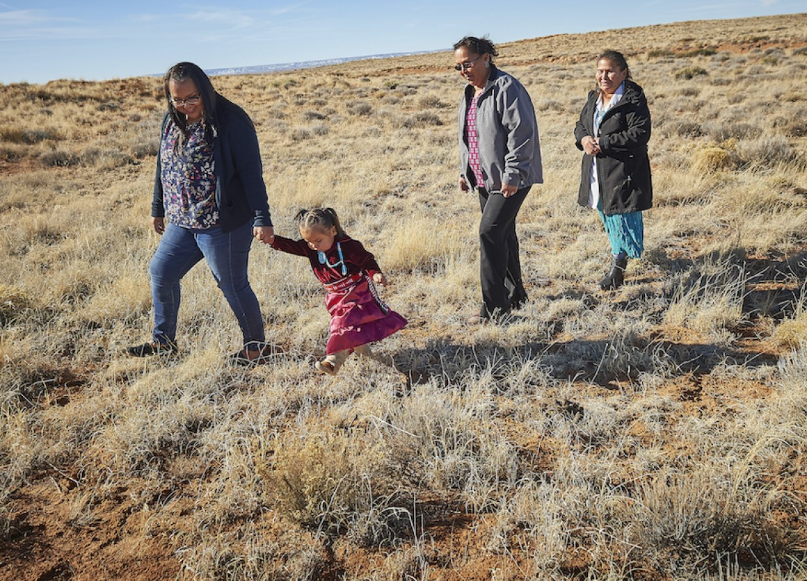 Three generations of a family, citizens of the Navajo Nation, are photographed in Central Chinle Agency in Arizona.