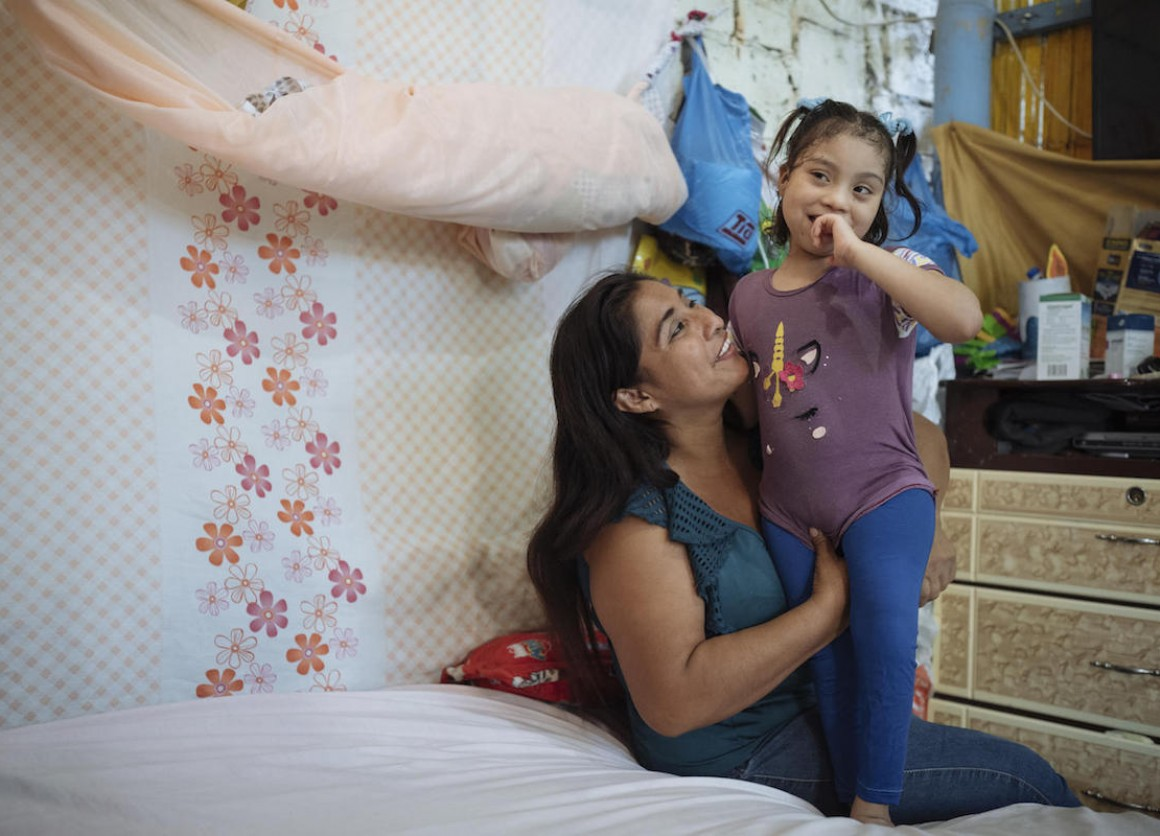 Magdalena, a UNICEF community health worker, and her daughter, Brithany, at home in Monte Sinaí, Guayaquil, Ecuador in 2021.