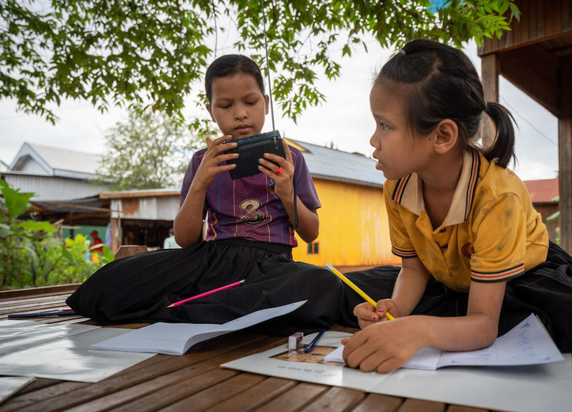 When their school was closed to prevent the spread of COVID-19, Kvas Em and Rocham Yhang kept up with their lessons via a radio provided by UNICEF in Paor Kekchong village, Borkeo District, Rattanakiri, Cambodia.