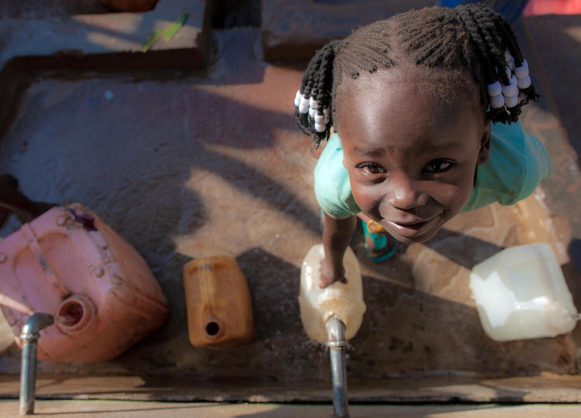 Five-year-old Queen Philip collects water at a UNICEF-supported water point in Yambio, South Sudan.