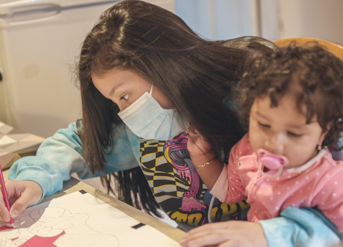Jennifer, 15, coloring with daughter Scarlett, migrated from Guatemala to the United States when she was 13. She made the trip with her sisters, eventually reunited with their mother in Hempstead, N.Y.