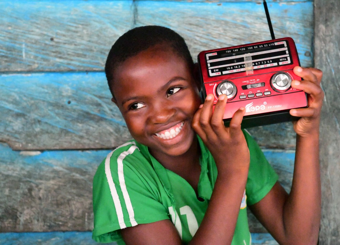 Keren, a 12 years old girl, is listening to a radio education program, in the community of Idinau, in the south west of Cameroon