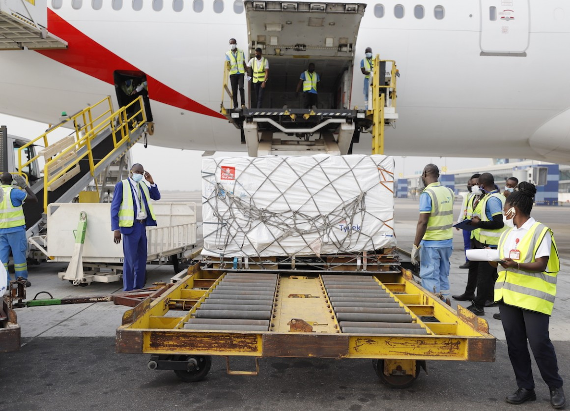 On 24 February 2021, staff unloads the first shipment of COVID-19 vaccines distributed by the COVAX Facility at the Kotoka International Airport in Accra, Ghana's capital.