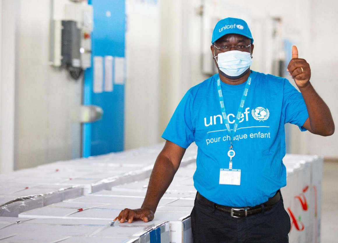 On February 26, 2021, UNICEF vaccine specialist Dr. Epa Kouacou celebrates the arrival of a shipment of COVAX COVID-19 vaccine doses in Abidjan, Côte d'Ivoire.