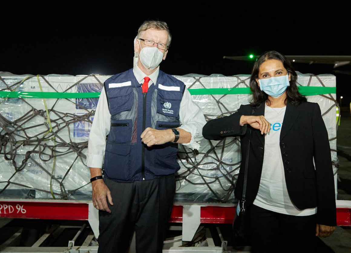 On March 3, 2021, WHO Kenya Representative Rudi Eggers (left) and UNICEF Kenya Representative Maniza Zaman receive the country's first COVID-19 vaccines from the COVAX facility at Jomo Kenyatta International Airport in Nairobi.