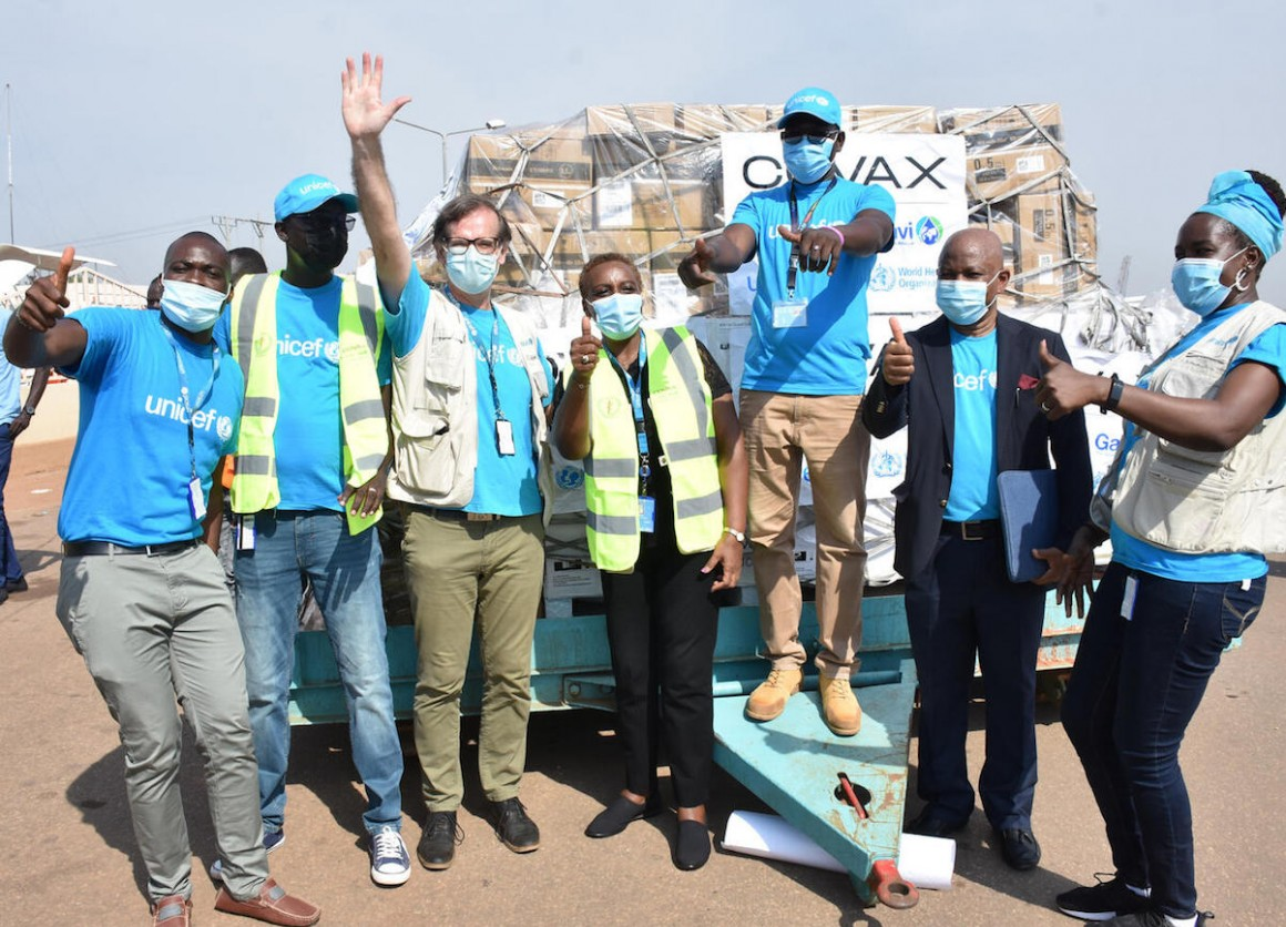 UNICEF staff cheering at Juba International Airport after the arrival of the first batch of COVID-19 vaccines in South Sudan via the COVAX Facility.