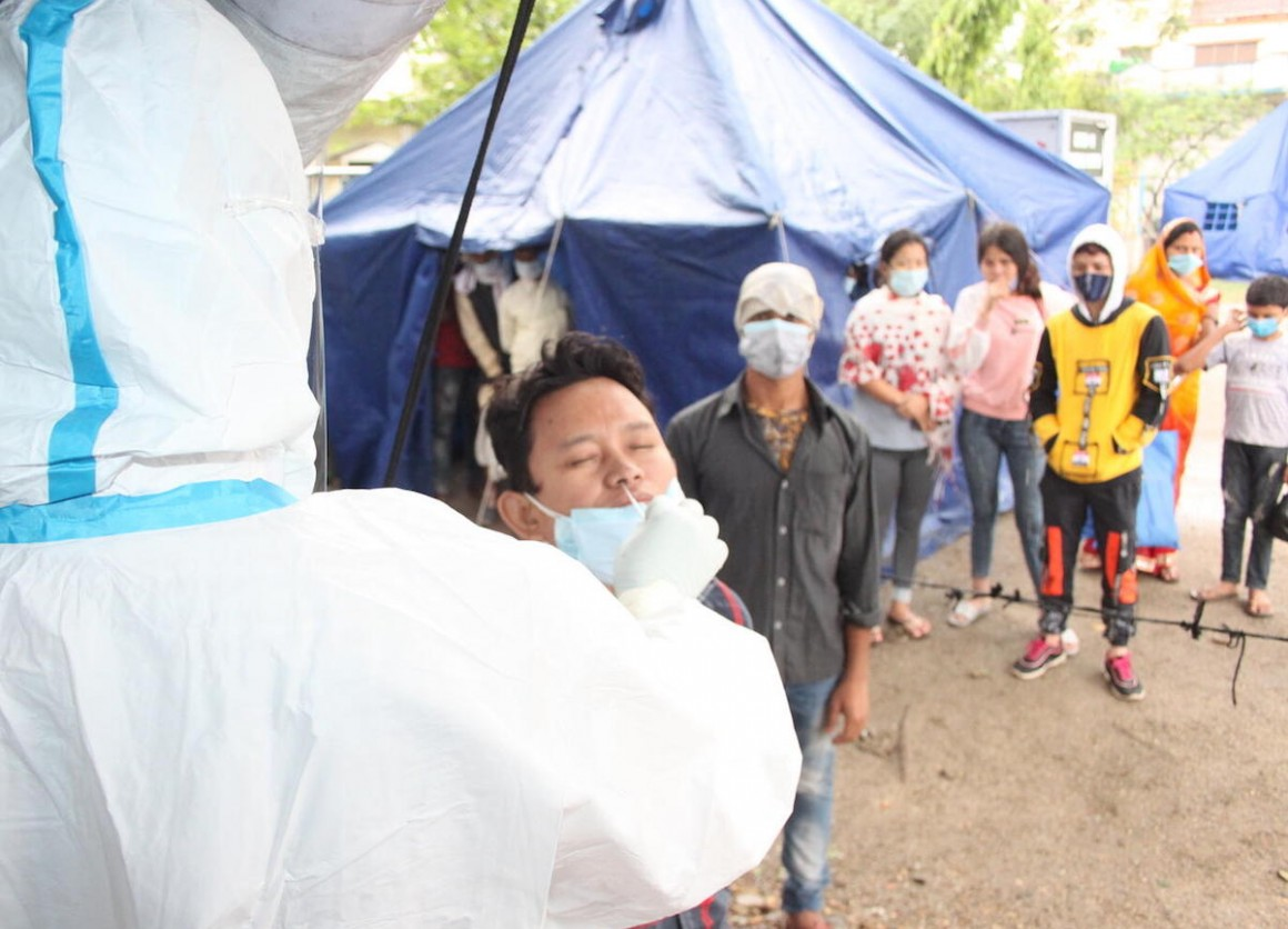 On May 5, 2021, individuals and families make the crossing from India into Nepal at the Birgunj point of entry in Parsa District in southern Nepal, where they are met by border personnel and health workers for temperature checks and antigen tests.