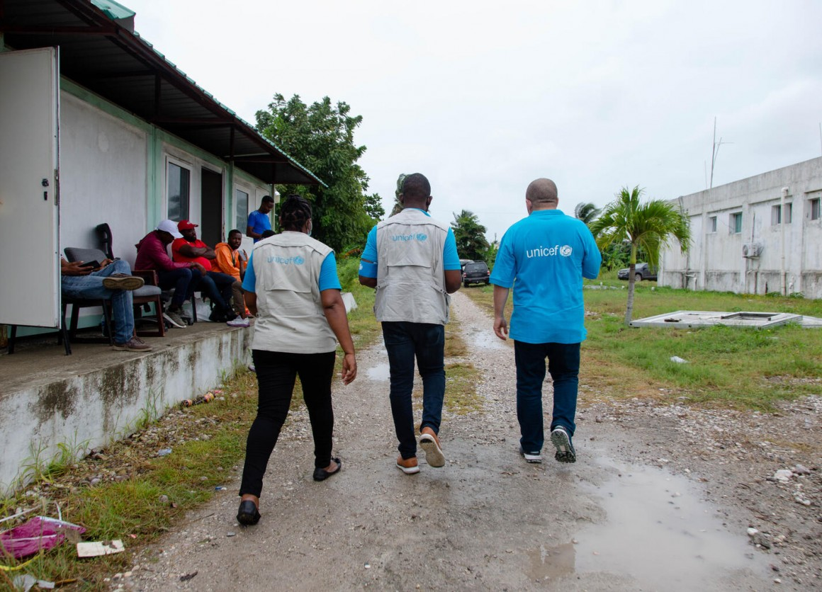 UNICEF representatives walk through the courtyard of Ofatma Hospital in Les Cayes, Haiti, on 17 August 2021. UNICEF installed tents in the courtyard shelter patients and their families who feared the hospital building could collapse.