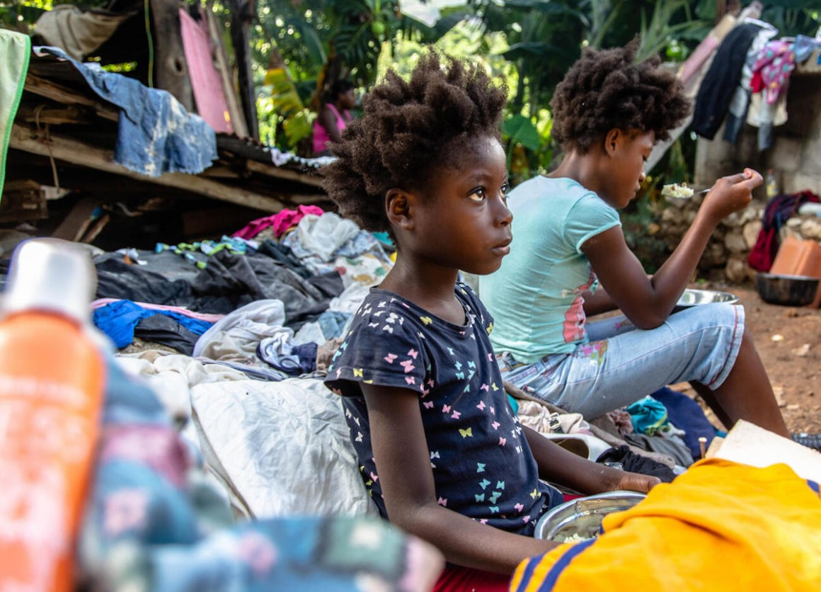 On August 18, 2021, 7-year-old Farah eats a meal at a temporary shelter in Marceline, Haiti. Farah spent two hours with his family under the rubble of their house after a 7.2 magnitude earthquake hit Haiti on August 14, 2021.
