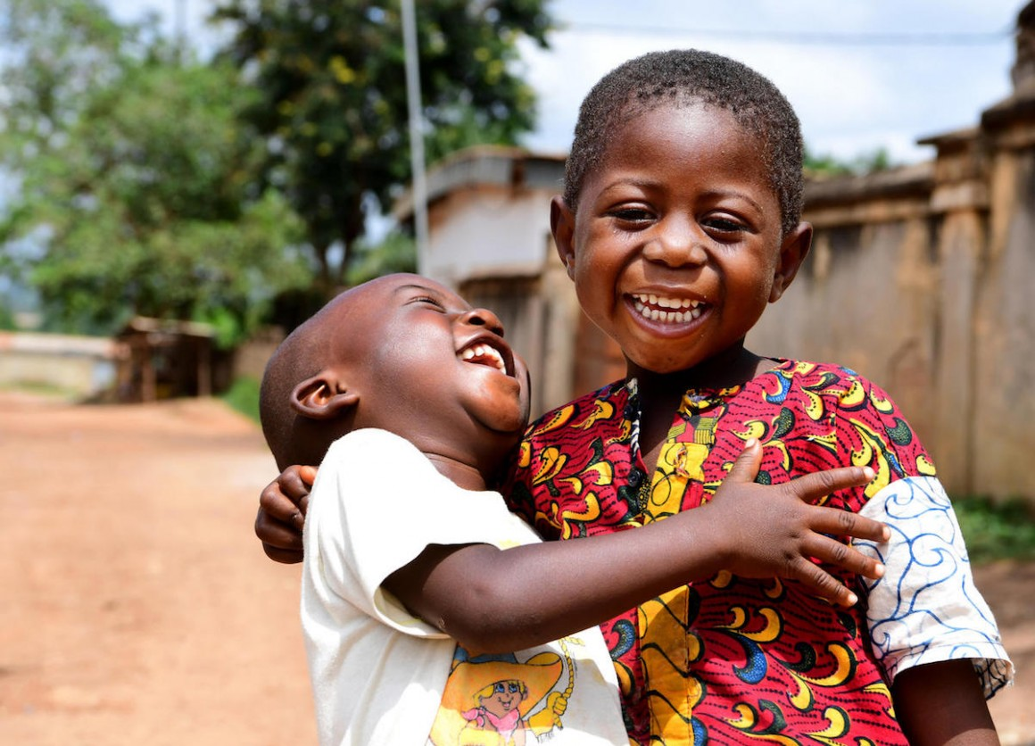 Two friends share a laugh in Korhogo, in the North of Côte d'Ivoire.