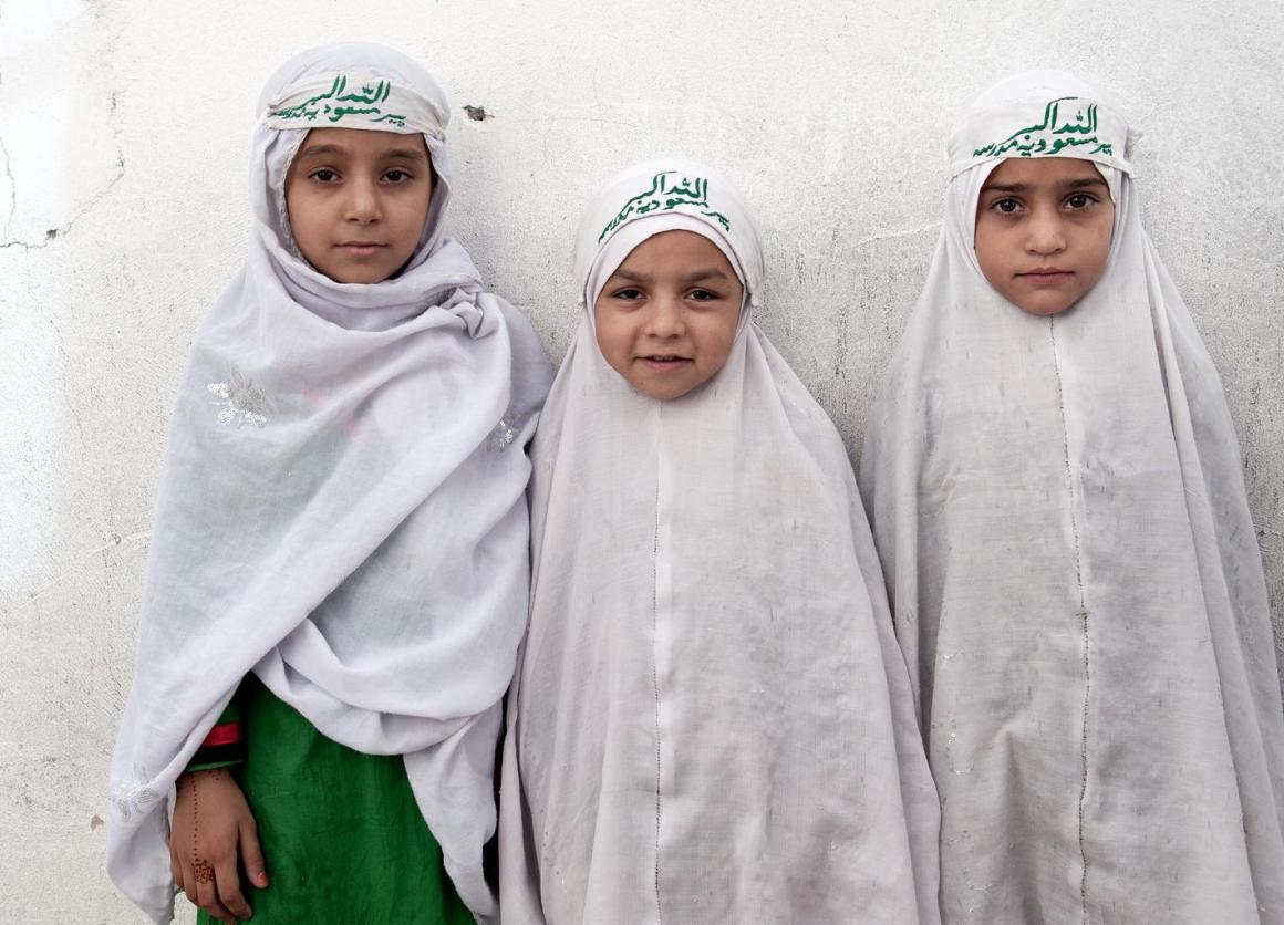 In July 2013 in Afghanistan, young girls stand by a wall at Peer Masoodia Madrasa in the southern city of Kandahar, capital of Kandahar Province. © UNICEF/NYHQ2013-0972/Dragaj