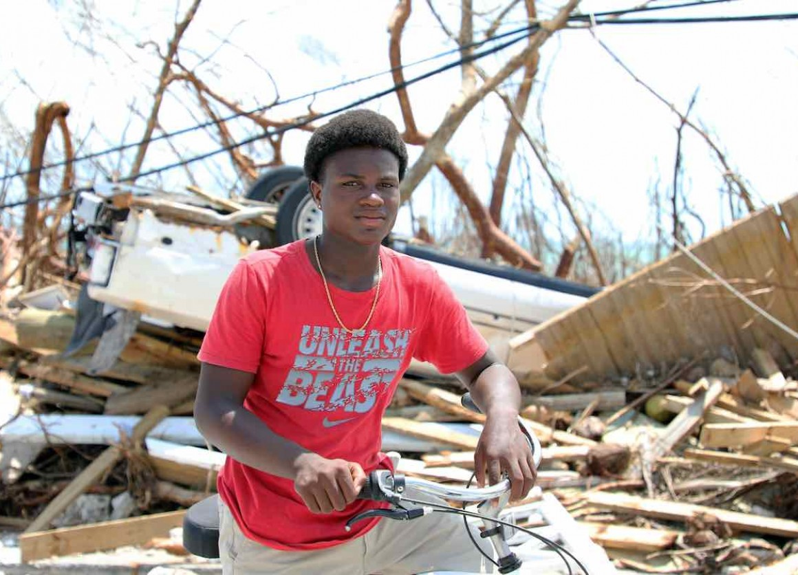 """On 6 September 2019, Benson Etienne, 15, rides his bicycle around the hurricane-hit Marsh Harbour, in Abaco Island. He was with his family in a two-story building when Hurricane Dorian slammed Abaco Island for 40 hours. """"Now everything is destroyed, every"""