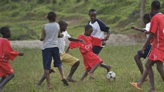 Children play football at a UNICEF-supported hostel for street children in Malawi.