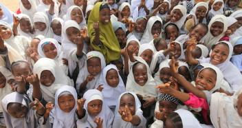 June, 2015. Girls at a religious school in Kano, Nigeria hold up their pinkies to show they have been immunized against polio.