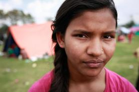 Chahana Dhami, 13, stands near a temporary shelter in Kathmandu following Nepal's massive earthquake. © UNICEF/NYHQ2015-1016/Nybo