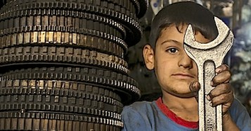 One of 3.3 million displaced Iraqis, Mustafa, 6, works with his father in an industrial area in Baghdad.