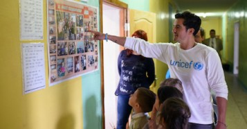 UNICEF Goodwill Ambassador Orlando Bloom visits with pupils of School #13 in Slovyansk, as part of a visit to conflict-hit eastern Ukraine.  He was in the country to raise awareness of the global education crisis facing children in emergencies.