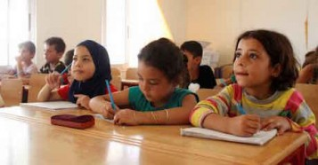 Fourth-grade classroom in a classroom in the Al Karnak camp, Tartous, Syrian Arab Republic.