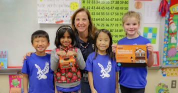 Dallas first grade teacher Andrea Brogan with some of her Trick-or-Treating for UNICEF student fundraisers.