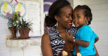Denee,28, says goodbye to her 19-month-old son, Justice, outside the daycare center where he stays while she teaches preschool on Nevis island, St. Kitts and Nevis, in July 2017.