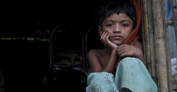 Rohingya refugee child outside her makeshift home in Cox's Bazar, Bangladesh, home to the largest refugee camp in the world.